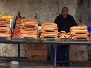 Buy bread from a street vendor.